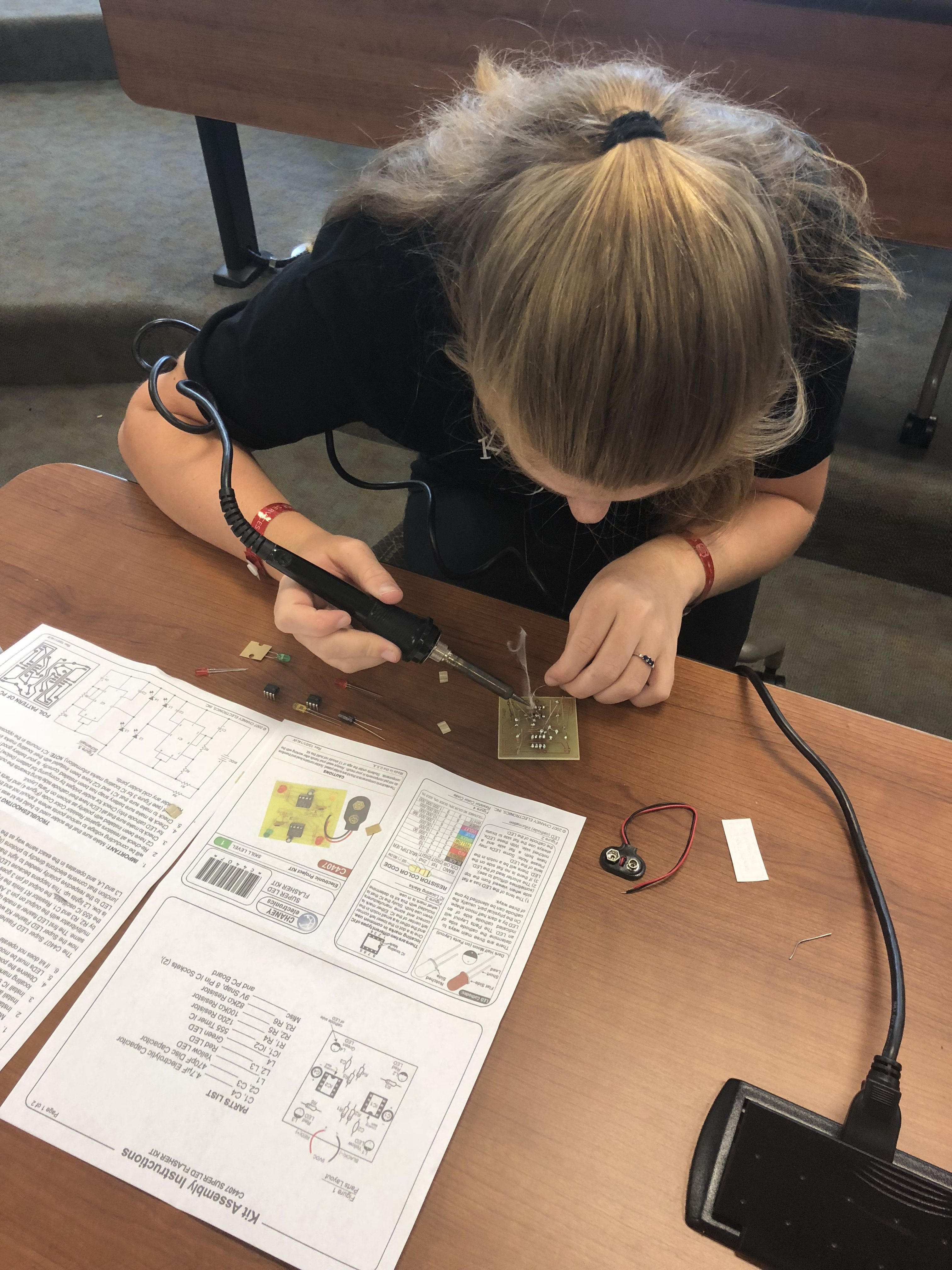 Dare County 4-Her, Madison Sawyer, learning how to solder at Electric Congress.