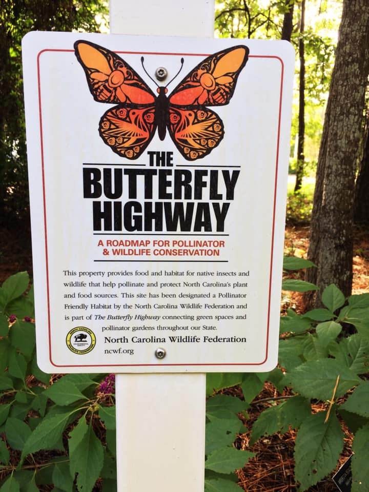 Image of a sign with a butterfly